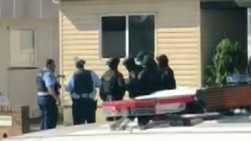 Witnesses filmed the moment a man was arrested. (9NEWS)
