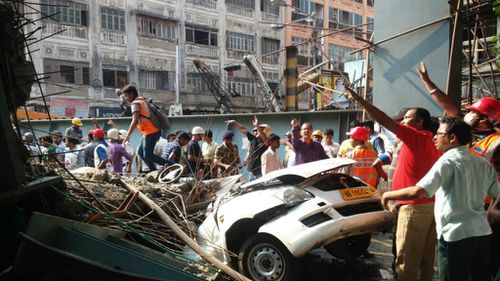 Cars and workers were trapped by falling debris. (AAP)