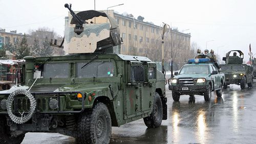 Afghan security forces arrive at the Kabul military academy after it was attacked earlier today. (Photo: AP).