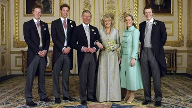 TRH Prince Charles and The Duchess Of Cornwall, Camilla Parker Bowles pose with their children (L-R) Prince Harry, Prince William, Laura and Tom Parker Bowles, in the white drawing room for the Official Wedding group photo following their earlier marriage at The Guildhall, at Windsor Castle on April 9, 2005 in Berkshire, England