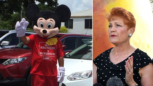 A Mickey Mouse costumed Labor supporter attempted to heckle Senator Hanson earlier on Friday in Ayr during her 'Battler Bus' tour (Image: Darren Curtis and AAP)