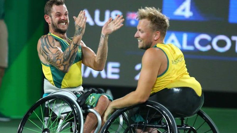 Dylan Alcott and Heath Davidson win Australia's first Paralympic gold medal in quad doubles wheelchair tennis.