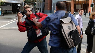 Mr Wilson struck out at News Corp Australia's Sam Mooy and shouted abuse as the photographer snapped him on the street. (AAP)