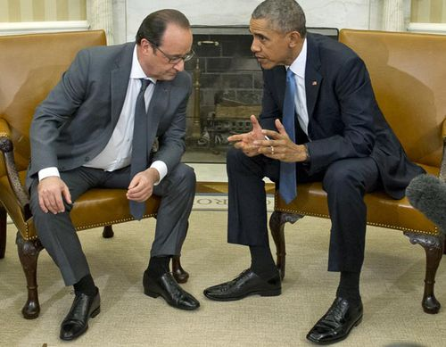 French President Francois Hollande (left) met with US President Barack Obama at the White House overnight. (Getty)