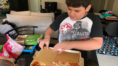 Giovanni with autism making lasagne