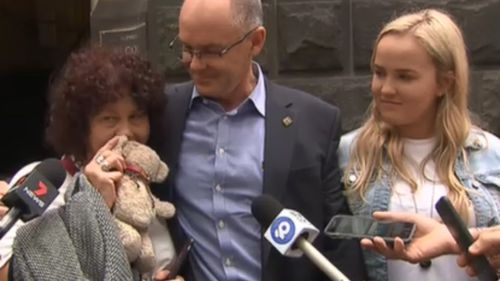 Robyn Cronin (left) holds her son's teddy bear outside the Court of Appeal in Melbourne today.