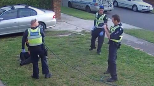 Three police officers have been charged over the incident.