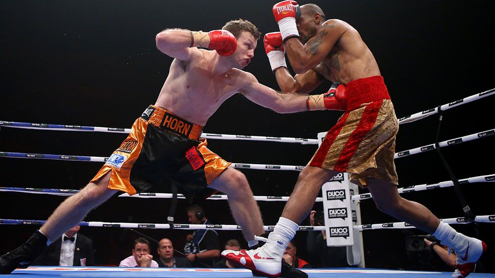 Jeff Horn connects with a left in his fight with Randall Bailey. (Getty)