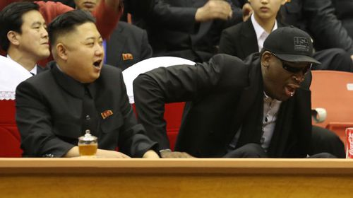 North Korean leader Kim Jong Un and former NBA star Dennis Rodman watch North Korean and US players in an exhibition basketball game. (AAP)
