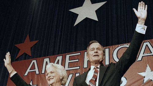 President-elect George H.W. Bush and his wife Barbara wave to supporters in Houston, Texas after winning the presidential election on Nov. 8, 1988