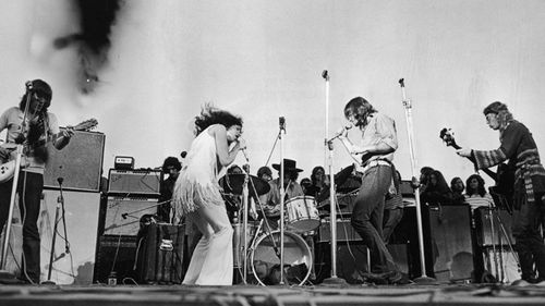 Singer Grace Slick performs with the American rock group Jefferson Airplane at Woodstock music festival.