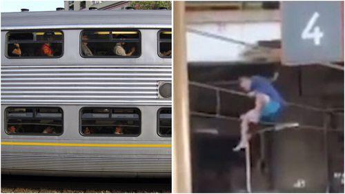 Man filmed holding overhead train wires in Redfern