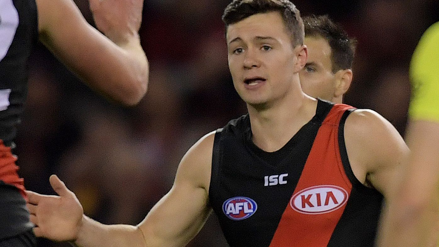 Bomber banned for biting by AFL tribunal