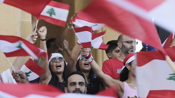 Anti-government protesters shout slogans against the Lebanese government during a protest in Beirut, Lebanon, Monday, Oct. 21, 2019.
