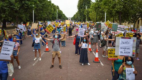 Healthcare workers take part in a protest over pay conditions in the NHS on August 8, 2020 in London, United Kingdom
