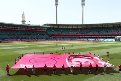 A giant pink banner is unfurled on Jane McGrath Day in 2019 in Sydney, Australia.