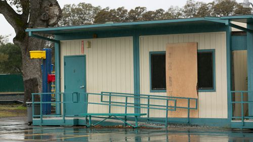 Plywood covers one of the windows at the Rancho Tehama Elementary School. (AAP)