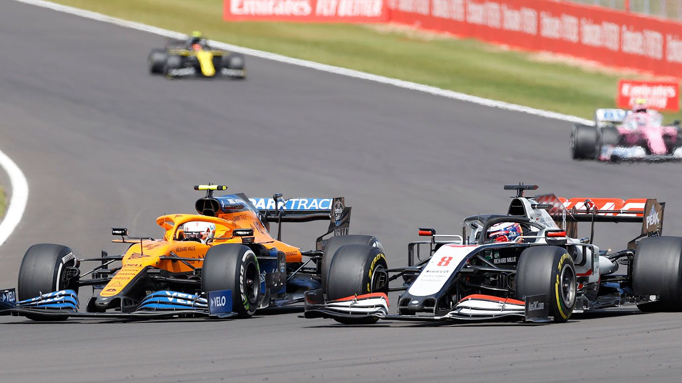 McLaren's Lando Norris passes Romain Grosjean during the British Grand Prix.