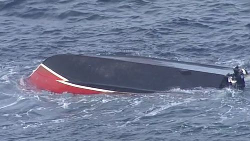 The boat overturned about 7am. (9NEWS)