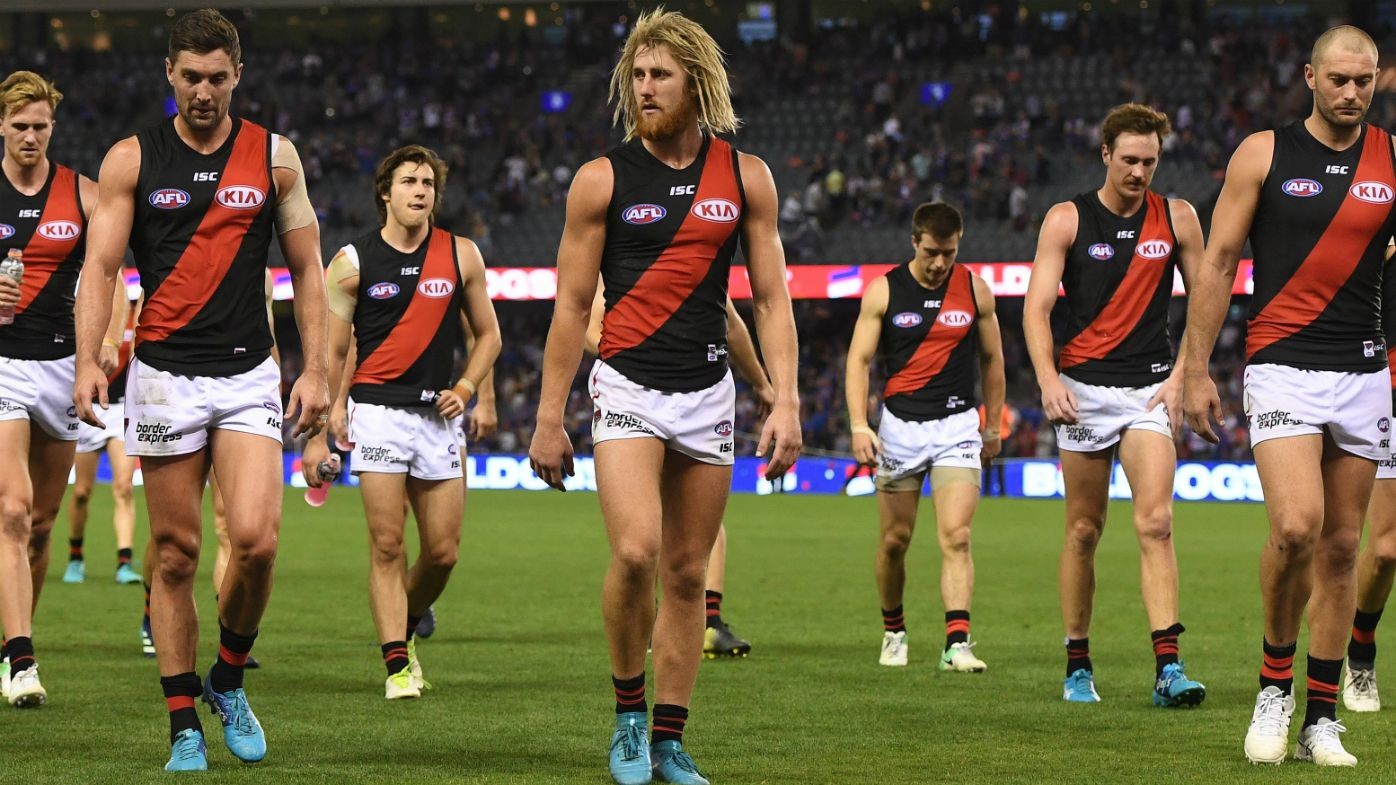 Essendon players leave field