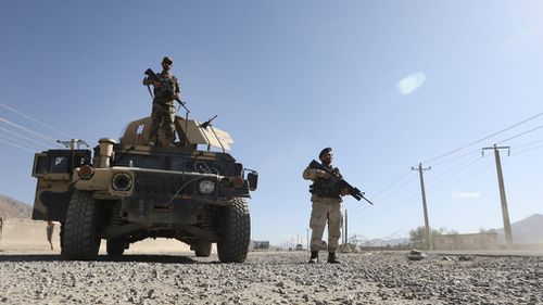 Afghan army soldiers stand guard in a checkpoint during the three-day ceasefire. Picture: EPA