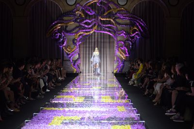 <p>The runway was decorated with 26,000 orchids which were laid under glass panels.</p>