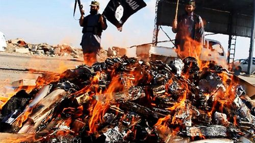 ISIL burn banned cigarettes and alcohol on bonfires