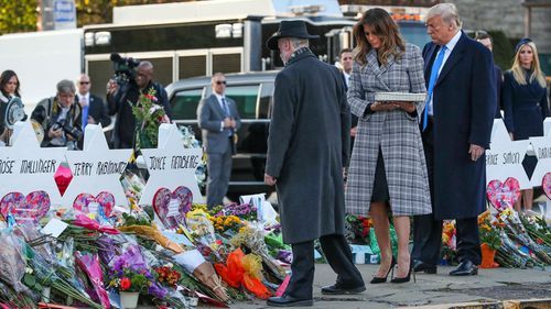 President Donald Trump and Melania lay a pebble and a flower on each memorial at the Tree of Life Synagogue in Pittsburgh.