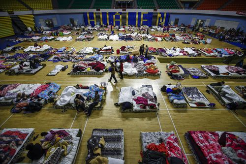 People displaced by the earthquake camp out at a gymnasium in Hualein. (AAP)