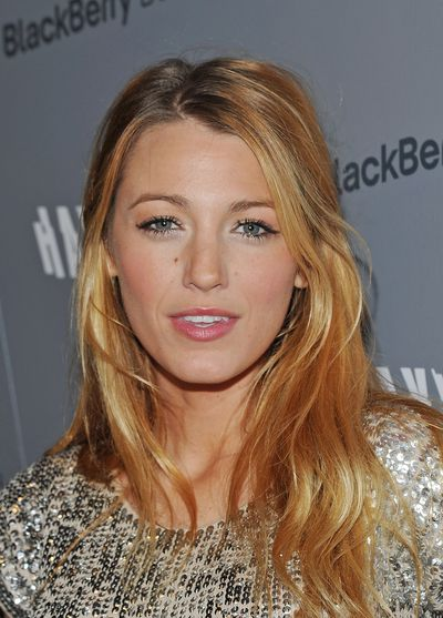 The wife of Ryan Reynolds went for loose, beachy waves and bold fluttery lashes to make a beauty statement with at theCinema Society & Blackberry Bold screening of 'Haywire' in New York, January 2012.