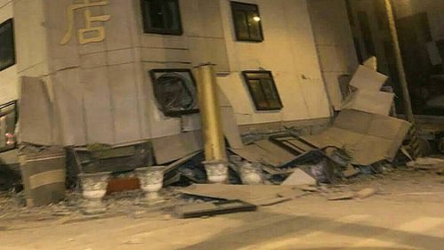 The earthquake has caused the bottom floors of a hotel to collapse. (AAP)