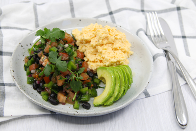 Healthy Mexican scrambled eggs with avocado and salsa
