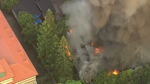 Fire has engulfed two buildings on Vulture Street in Brisbane's south.