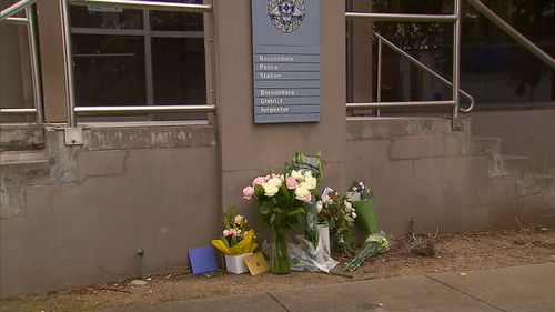 Tributes to four police officers have been left at the Boroondara Police Station in Kew.