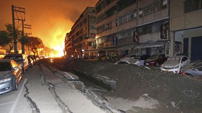 A road that has cracked open from the force of an explosion in Taiwan. (AAP)