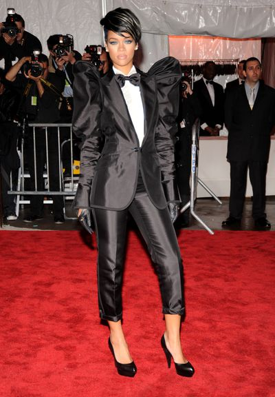 Rihanna in a black suit and white ruffle shirt by Dolce & Gabbana at the 2009 Met Gala in New York City
