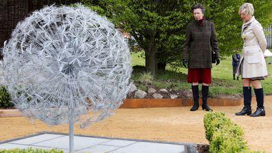 Princess Anne views the  commemorative wire dandelions at Cheltenham General Hospital