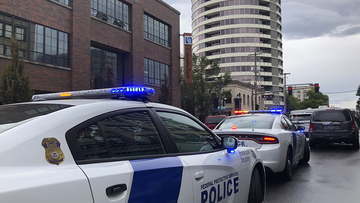Police respond to a shooting at an apartment building, top rear, in Vancouver, Wash., Thursday, Oct. 3, 2019. Authorities said multiple people were struck. (AP Photo/Gillian Flaccus)