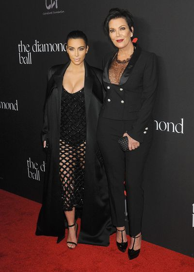 Kim Kardashian West and Kris Jenner, both in Balenciaga, at Rihanna's First Annual Diamond Ball in Beverly Hills, December, 2014