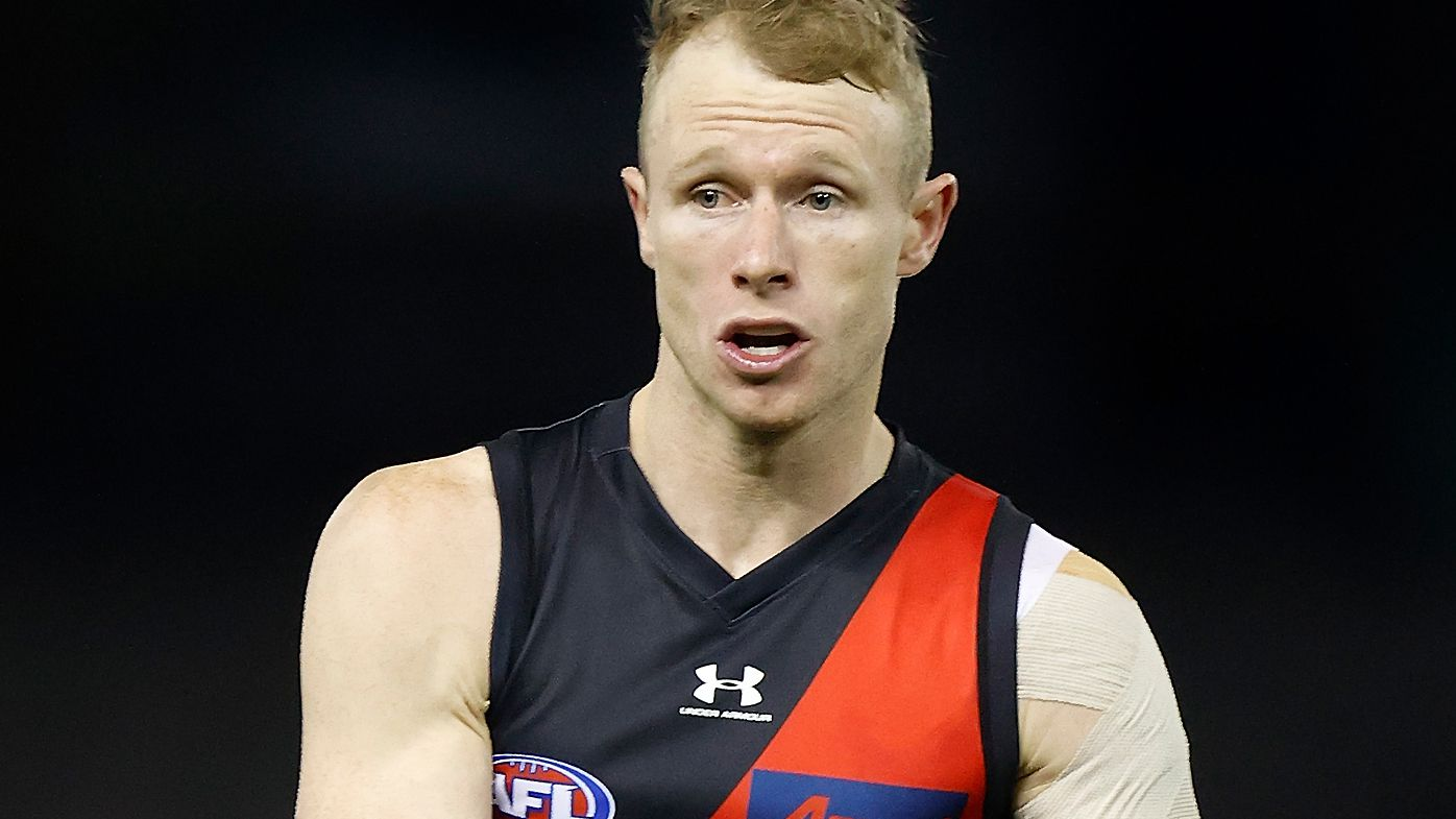 Essendon Bombers' Nick Hind ruled out of AFL finals clash against the Bulldogs after visiting a COVID-19 exposure site