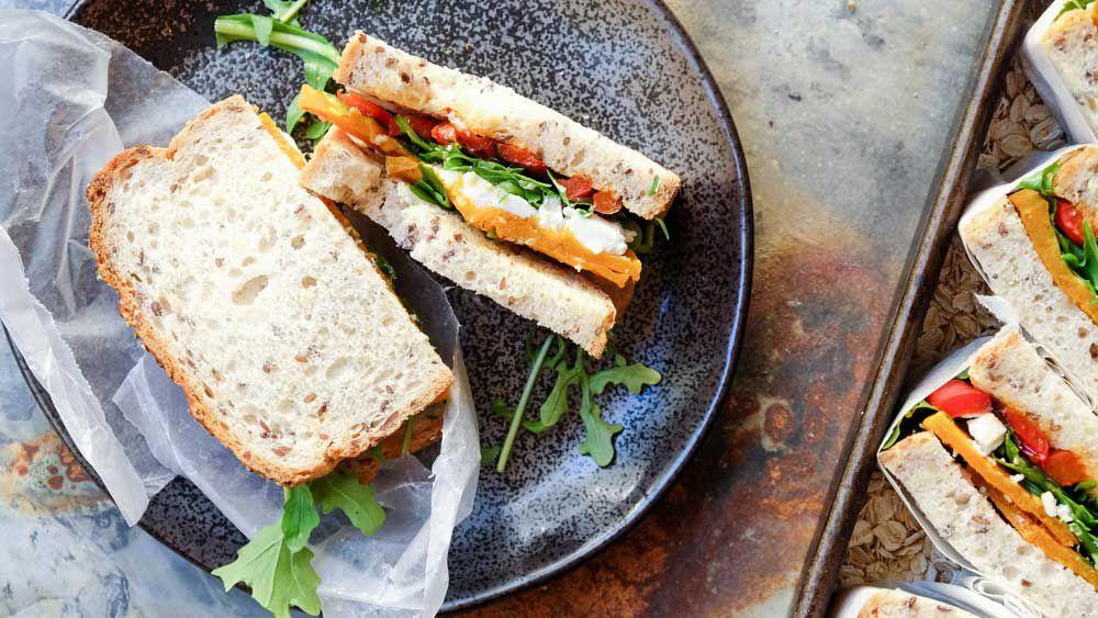 Roasted pumpkin, feta, rocket and capsicum sandwich recipe by Abbott's Village Bakery