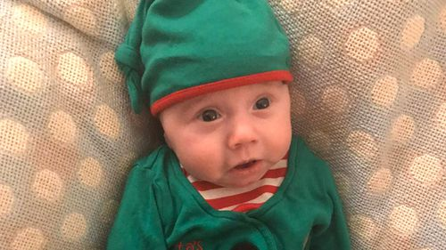 UK baby flashes first smile before Christmas after dangerous cyst removed