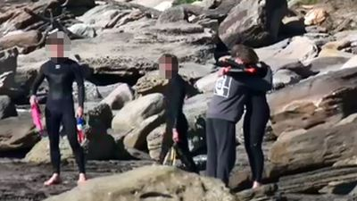 Anguished friends dragged surfer to shore before death