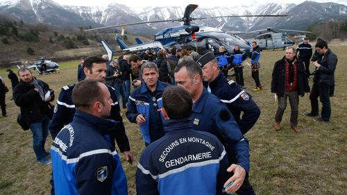 Rescue workers and gendarme gather in Seyne-les-Alpes. (AAP)