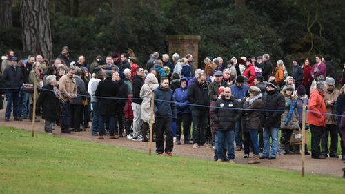 Crowds wait for the arrival of the royal family. (Joe Giddens/PA Wire)