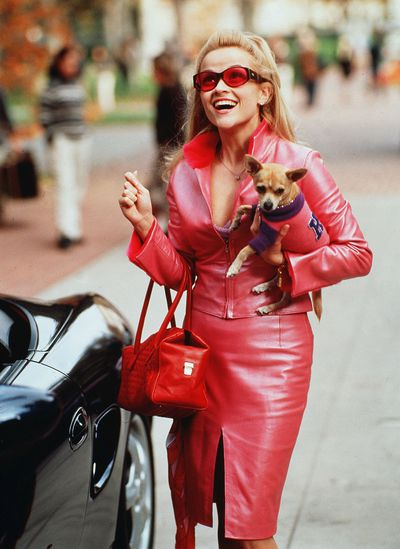 """Start practising your bend and snap and dusting off your pink pillbox hats, Reese Witherspoon has confirmed that<em> Legally Blonde 3</em> is, like, totally happening.<br /> <br /> Signed, sealed and confirmed by the actress herself on<a href=""""https://www.instagram.com/reesewitherspoon/?utm_source=ig_embed"""" target=""""_blank"""" draggable=""""false"""">Instagram</a>, she paid homage to Elle Wood's iconic Harvard admissions video by slipping into a pink sparkly bikini and floating across her pool.<br /> <br /> """"It's true.. #LegallyBlonde3"""" the actress wrote in a caption accompanying the clip.<br /> <br /> Besides making it impossible for us to forget the important things in life such as showers and perms don't go together, and that a scented resume always goes a long way, Elle Woods was a trail-blazer in the style stakes.<br /> <br /> From her ability to never be afraid of standing out in her signature colour; """"Whoever said orange was the new pink was seriously disturbed"""", to giving garments such as berets and off-the-shoulder-tops her sartorial tick of approval long before Gigi and Kendall did, the fictional lawyer is an enduring style icon on-and-off screen.<br /> <br /> In honour of <em>Legally Blonde 3</em> (slated to hit cinemas in February 2020) we look back at some of Elle Woods biggest style moments. Snaps."""