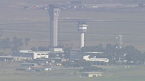 Flights have been suspended at Melbourne Airport after a fire alarm sounded in a control tower.