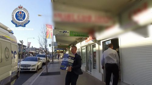 Police took computer hard drives and business documents from the pawn shop.