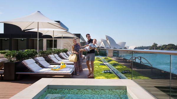 Family on sunbeds at the Park Hyatt Sydney rooftop