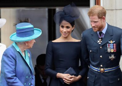 Queen Elizabeth with The Duke and Duchess of Sussex.